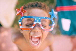 Boy wearing American flag frames with stars