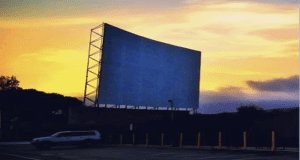 drive-in theater screen at dusk