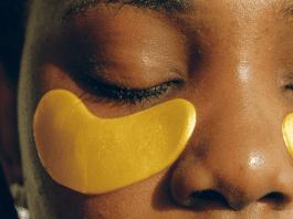 African American woman wearing gold under eye gel masks