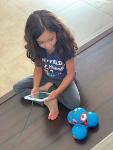 girl playing with robot