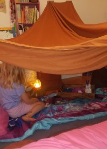 indoor sheet tent with sleeping bags and indoor s'mores kit
