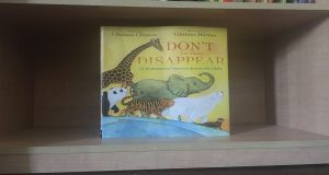 Don't Let Them Disappear displayed on a bookshelf