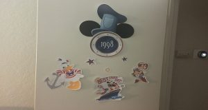 A door decorated with cut outs of Disney characters