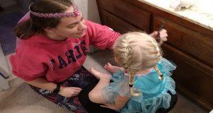 Toddler receiving a princess makeover