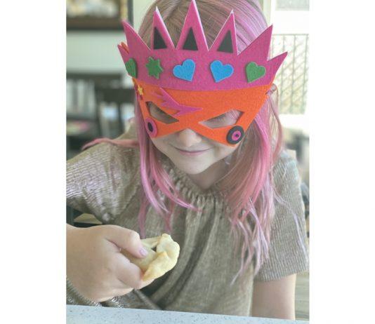student eating hamantaschen