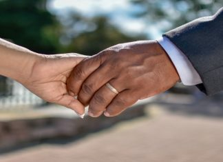 image of two hands holding each other