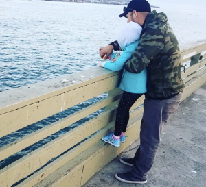 fishing on a pier - father and child